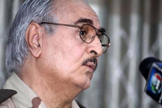 Retired Libyan Army general Khalifa Haftar speaks during a press conference in the town of Abyar, May 17, 2014
