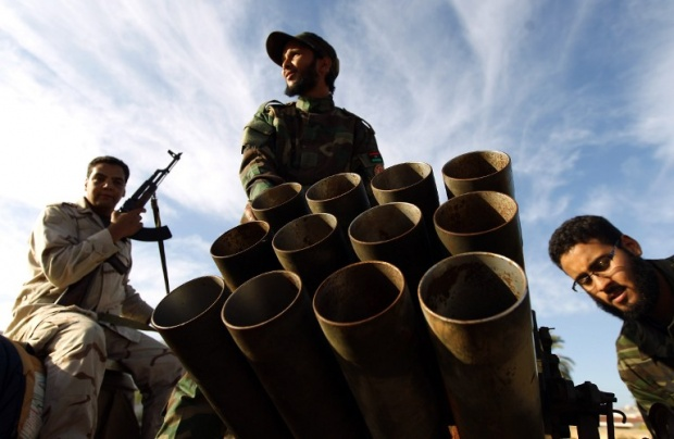 Fighters loyal to the Libyan army battle Islamist militias in Benghazi last month (AFP) -