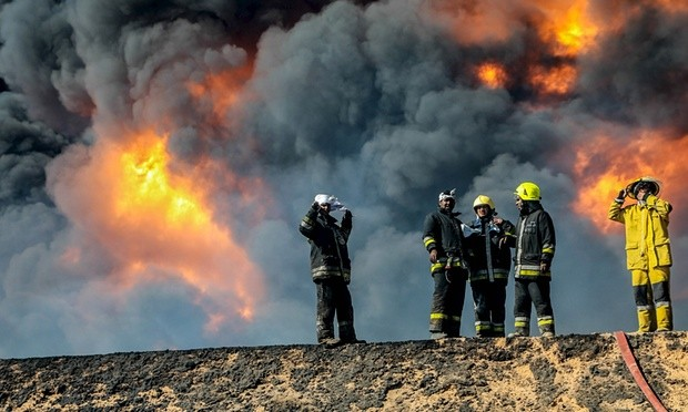 Firefighters try to extinguish an oil tank blaze after Isis militants attacked Ras Lanuf and the nearby terminal of Es Sider. Photograph: Reuters
