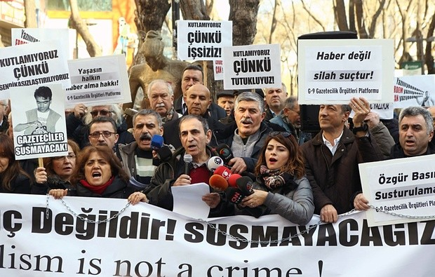 A demonstration in Ankara, in support of Dündar and Gül. One banner reads: 'Journalism is not a crime!' Photograph: Adem Altan/AFP/Getty Images