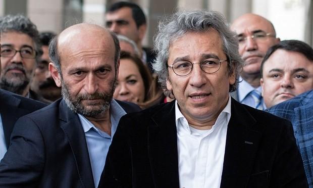 Erdem Gül (left) and Can Dündar speak to the media outside court in Istanbul, Turkey. Photograph: Vedat Arik/AP