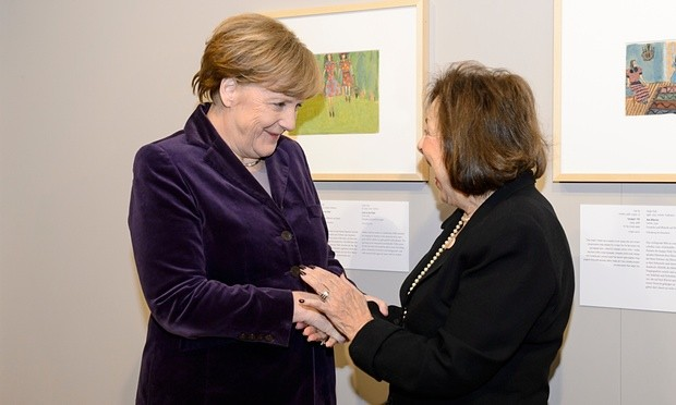Angela Merkel greets Nelly Toll. Photograph: Pool/Getty Images