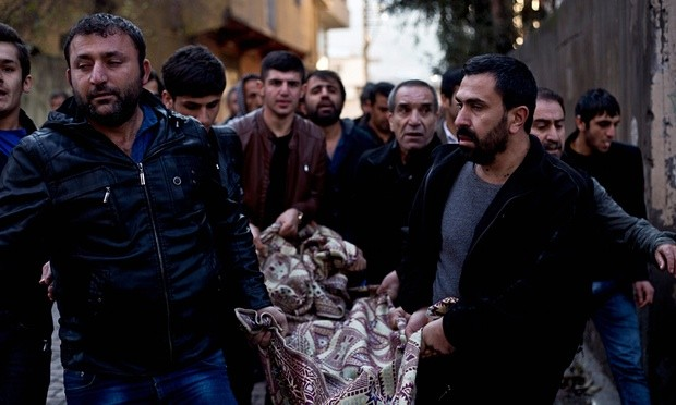 Kurds carry the body of a man killed during fighting with security forces in Sirnak, south-eastern Turkey, on Sunday 10 January. Photograph: Refik Tekin/EPA
