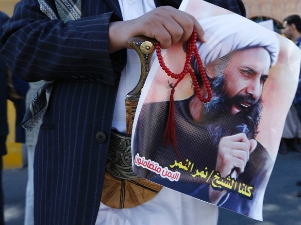 A Shia protester carries a poster of Sheikh Nimr al-Nimr during a demonstration outside the Saudi embassy in Yemen during October last year. (Khaled Abdullah-Reuters)
