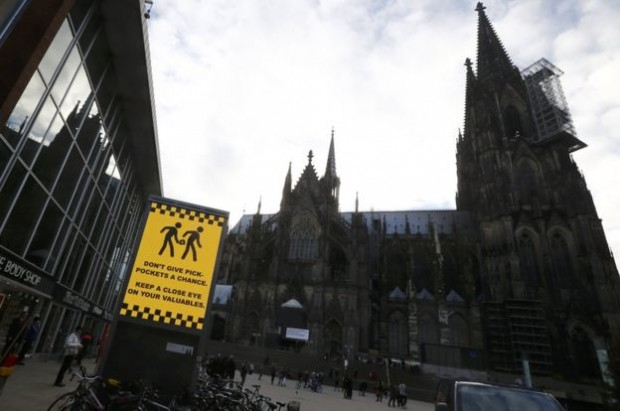 A sign outside Cologne's central station warns about pickpockets
