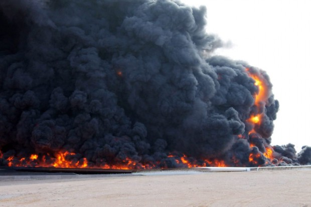 In a file photo from December 2014, smoke rises from a large fuel depot fire during fighting in Es Sider, Libya. PHOTO: STRINGER/EUROPEAN PRESSPHOTO AGENCY
