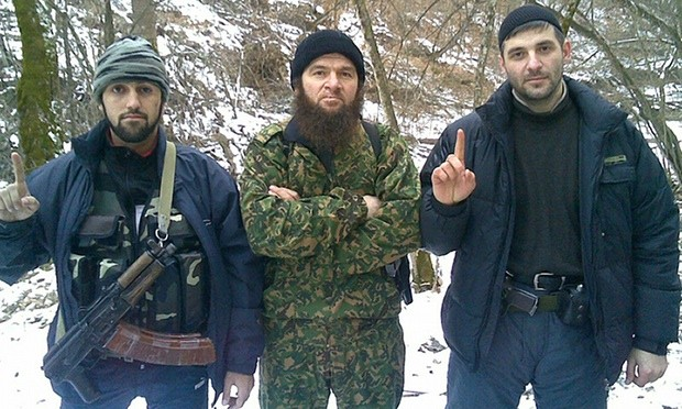 Chechen Emirate leader Doku Umarov, centre, poses with two unidentified fighters in an image believed to have been taken in 2010. Photograph: HO/AFP/Getty Images