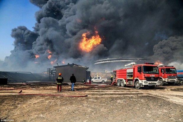 Firefighters extinguished two fires at oil storage tanks at Libya's Ras Lanuf terminal on Monday, but blazes continued at five tanks in the nearby port of Es Sider at the same time