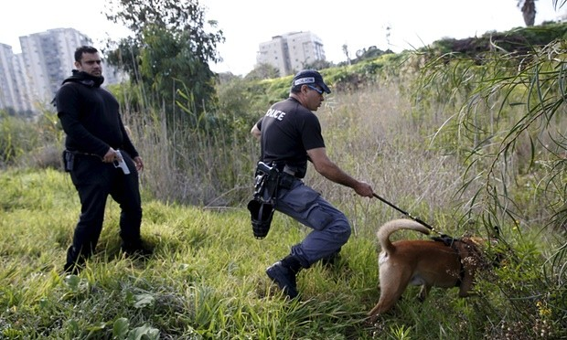 Israeli police searching for the Tel Aviv shooting suspect earlier this week. Photograph: Baz Ratner/Reuters