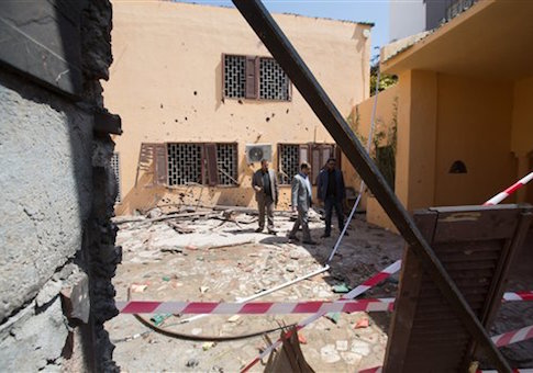 Officials survey the grounds of the the Moroccan Embassy in Libya after a bomb claimed by ISIS exploded / AP