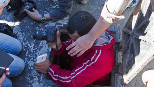 On Saturday journalists went to see the manhole through which Guzman tried to escape during the operation on Friday