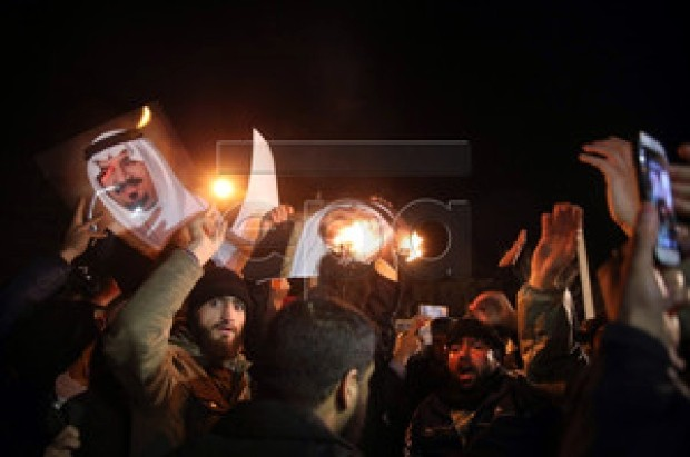 Protesters in Tehran burn pictures of a member of the Saudi royal family in front of the Saudi Arabian embassy. (EPA-MOHAMMAD REZA NADIMI)