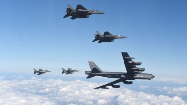 The B-52 - capable of carrying a nuclear bomb - was flanked by US and South Korean fighter jets