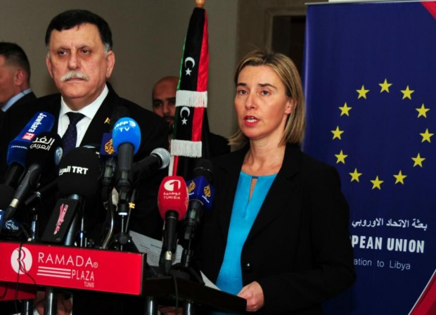 Libyan prime minister Fayez Sarraj, left, and European Union foreign policy chief Federica Mogherini participate in a media conference in Tunis, Tunisia, Friday, Jan. 8, 2016. European Union foreign policy chief Federica Mogherini has announced a 100-million euro aid ($109 million) for Libya's UN.-supported unity government, one day after the attack that killed at least 60 policemen in the Libyan town of Zliten. Mogherini condemned the attack, in a joint press conference with Libyan prime minister Fayez Sarraj Friday in Tunis.  (AP Phhoto/Hassene Dridi)