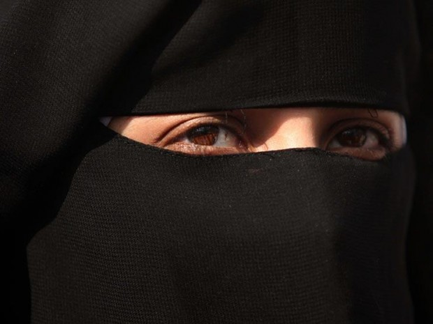 David Cameron has said he will back the right of schools, courts and other British institutions to ban Muslim women from wearing veils Rex Features