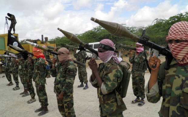 Al-Shabaab fighters display weapons as they conduct military exercises in Mogadishu, Somalia on Oct. 21, 2010.Mohamed Sheikh Nor/AP