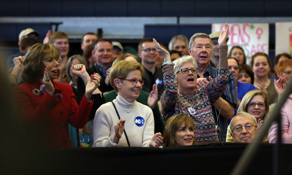A crowd cheered for Hillary Clinton at a campaign event on Tuesday at Nashua Community College in New Hampshire. Credit Richard Perry/The New York Times