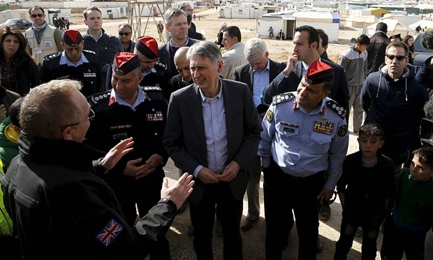 Philip Hammond, centre, in Mafraq, Jordan, on Monday. Photograph: Muhammad Hamed/Reuters