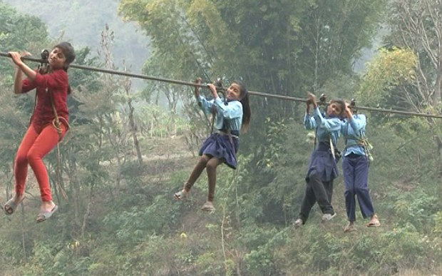 Schoolgirls in a rush to cross Trishuli River on their way to school   Photo: Manish Duwadi / Barcroft India