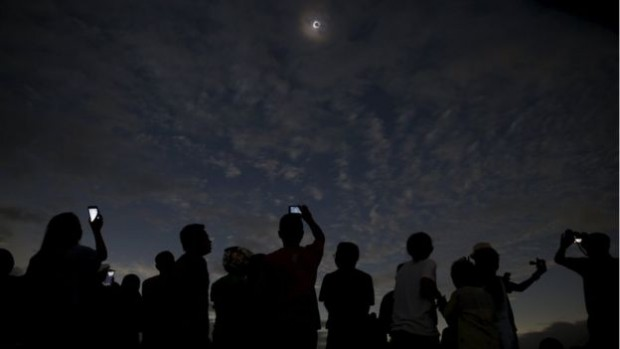 In Indonesia, crowds gathered at viewing points to witness the eclipse as it happened