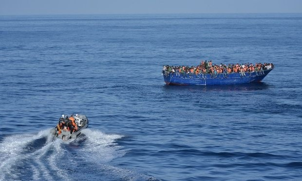 Patrols rescue people from overcrowded boats but critics say smugglers are using them as a 'ferry service'. Photograph: AFP/Getty Images