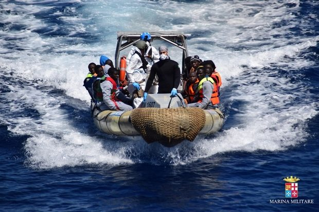 Picture released by the Italian Navy shows a rescue operation of migrants and refugees at sea, off the coast of Sicily, on 11 April 2016 (AFP)