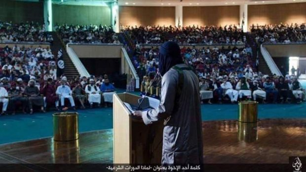"""Expand An ISIS lecture on Sharia (Islamic law) at the Ouagadougou complex in Sirte, Libya, where former Libyan leader Muammar Gaddafi once hosted summits with world leaders. The caption in Arabic reads: """"Speech by one of the brothers (why we are holding Sharia sessions)"""" ISIS 2016 image, circulated on social media."""