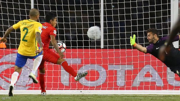 FOXBORO, MA - JUNE 12:  Raul Ruidiaz #11 of Peru scores on Alisson Becker #1 of Brazil in the second half during the 2016 Copa America Centenario Group B match against Brazil  at Gillette Stadium on June 12, 2016 in Foxboro, Massachusetts. (Photo by Jim Rogash/Getty Images)