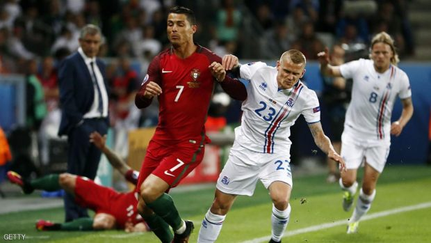Portugal's forward Cristiano Ronaldo (L) and Iceland's defender Ari Skulason vie for the ball during the Euro 2016 group F football match between Portugal and Iceland at the Geoffroy-Guichard stadium in Saint-Etienne on June 14, 2016. / AFP / ODD ANDERSEN        (Photo credit should read ODD ANDERSEN/AFP/Getty Images)