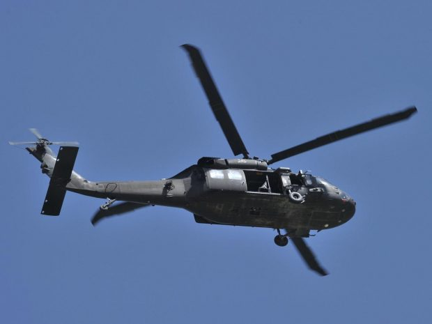 Seven military personnel and one civilian landed in northern Greece in a Blackhawk helicopter AFP/Getty