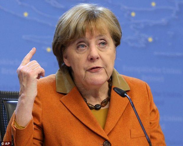 Angela Merkel faces possible defeat in German regional poll
