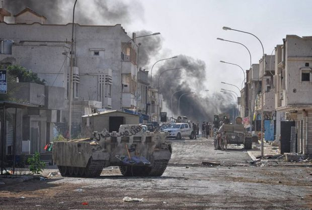 18 dead as Libyan forces confront IS