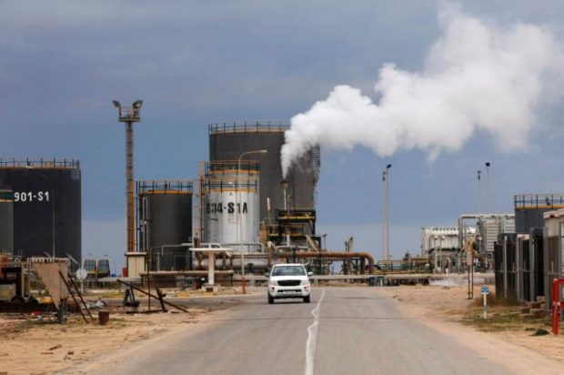 Rival east Libya factions battle for crucial oil ports