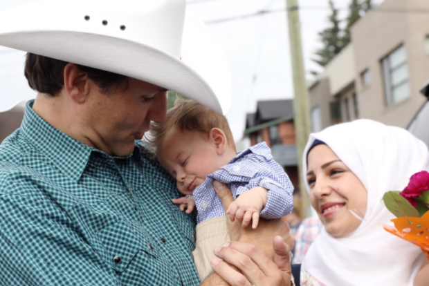 Canada's Trudeau meets tiny namesake, the son of refugees