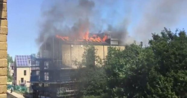 Large blaze breaks out at an unoccupied building in London