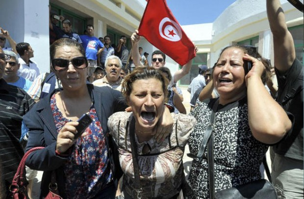 TUNISIA, ARIANA : Tunisians react outside a hospital after the killing of the opposition politician Mohamed Brahmi on July 25, 2013 in Ariana, outside Tunis.