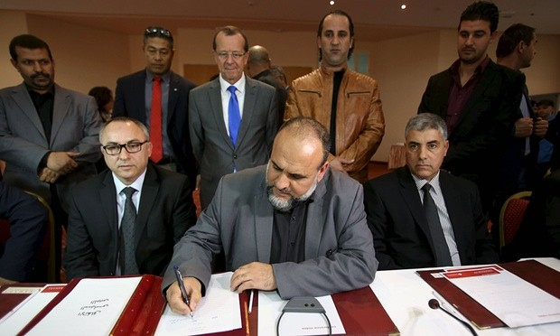 Representatives of Libyan municipalities sign documents to support the new national government on Monday. Photograph: Zoubeir Souissi/Reuters