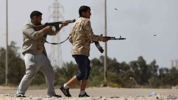 Fighters fire at Islamic State militants near Sirte on March 15, 2015