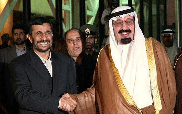 Former presidents of Saudi Arabia and Iran shaking hands