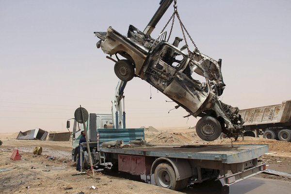 Wreckage of a vehicle after an attack by a suicide car bomber at a checkpoint near Misurata, Libya in May. The Islamic State claimed responsibility for the attack. Credit Reuters