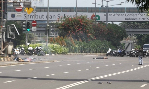 Police chase suspects after a series of blasts hit the Indonesia capital Jakarta. Photograph: Azqa/Jefta/Barcroft Media