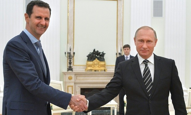 Vladimir Putin shakes hands with Bashar al-Assad in the Kremlin in October. Photograph: Alexei Druzhinin/AP