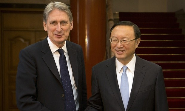 British Foreign Secretary Philip Hammond, left, shakes hands with Chinese State Councillor Yang Jiechi. Photograph: Pool/Getty Images