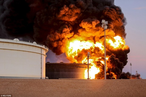 Fire rises from an oil tank in the port of Es Sider, in Ras Lanuf, which was said to have been attacked by ISIS militants