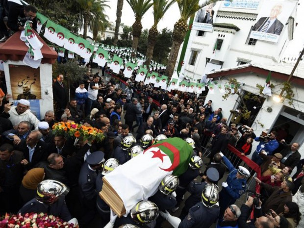Firemen carry the coffin of opposition leader Hocine Aït Ahmed in Algiers AFP