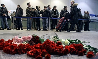 Flowers laid at Domodedovo airport the day after 37 people were killed in a suicide blast in January 2011. Photograph: Sergey Ponomarev/AP