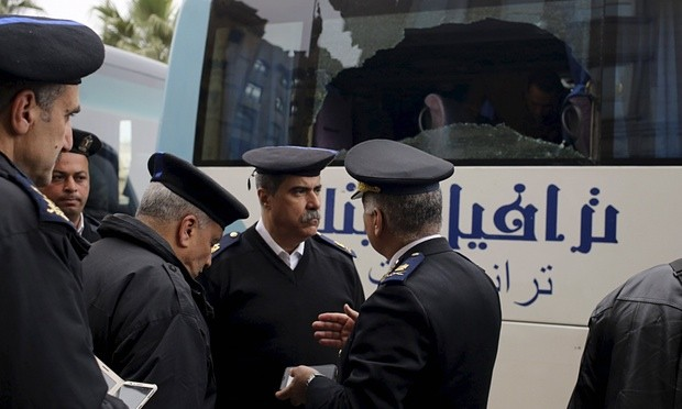Police examine a tourist bus in Cairo