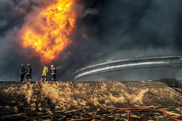 Rescue workers responded to an oil tank fire in Ras Lanuf, Libya, caused by a bombing, one of several in the country this month. Credit Reuters