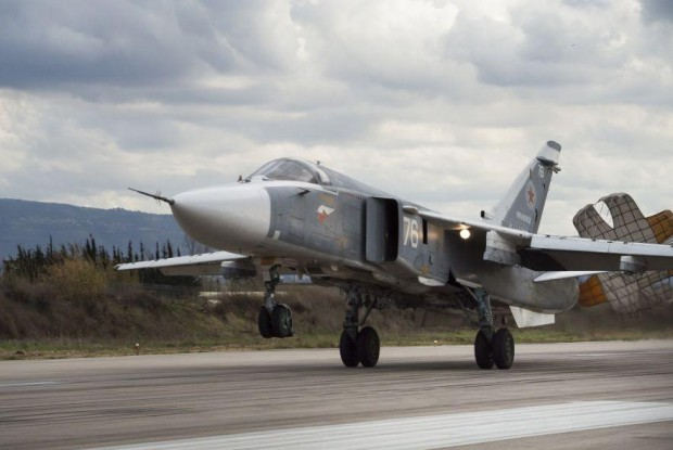 An Su-24 bomber – which has its origins in the late 1960s – lands at Hemeimeem air base in Syria