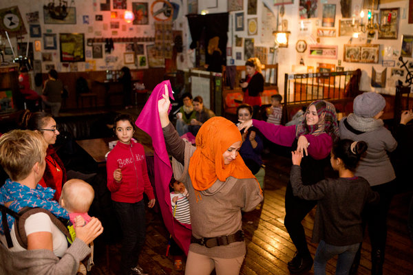 "Samar danced at a women's ""coffee hour"" at a local cafe organized by the shelter in Berlin. Credit Djamila Grossman for The New York Times"